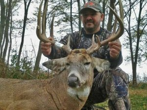 Happy hunter with tagged out white tail