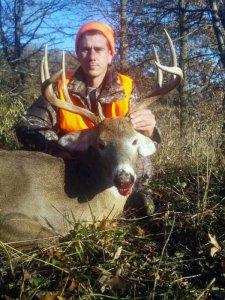Hunter with harvested deer