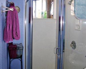 Purple Towel Near Shower