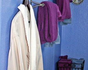Bathrobe and Purple Towels