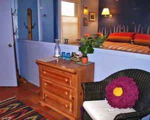 Dresser Near Chair with Flower Pillow