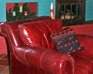 Close-up of Red Leather Chair with Pillow