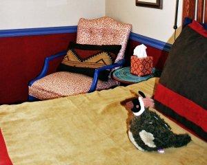 Plush Quail on Bed Near Chair