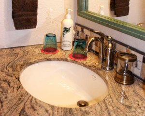 Soap and Glasses on Bathroom Counter
