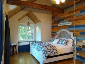 bed against wood wall