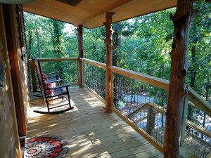 two rocking chairs on treehouse porch