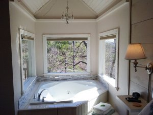 jetted bath surrounded by windows