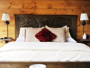 bed with ornate headboard and pillows