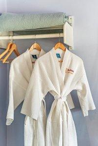 two hanging bathrobes