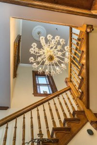 winding staircase around chandelier