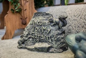carved rock that says welcome to my garden