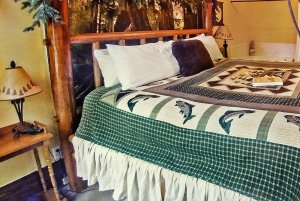 fishing-themed bedding on wooden bed