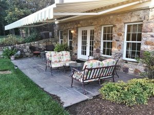 Outdoor patio with awning shading a seating area
