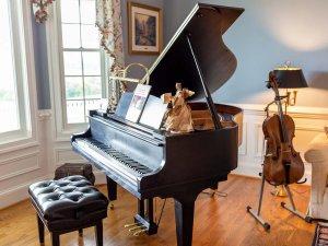 Piano and cello next to window