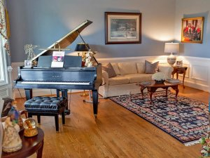 Grand piano and couch in living room