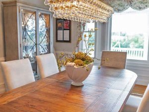 Dining table across from window and display cabinets