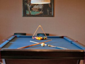 Cues and balls on pool table