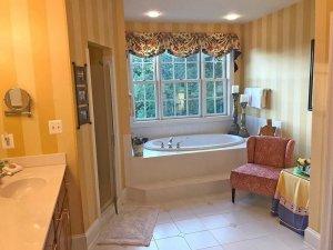 deep bathtub in a clean bathroom