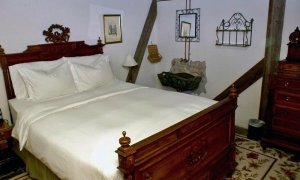 Wooden Bed with White Bedding