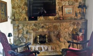 Stone Fireplace with Television