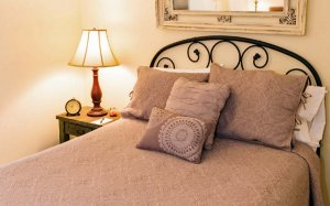 A bed with beige covers
