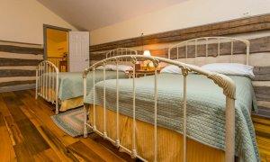 Two beds in an upper-floor room