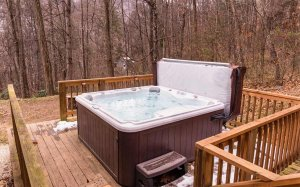 A hot tub on a deck in winter
