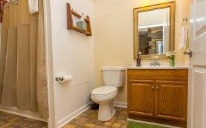 Bathroom sink, mirror, and toilet