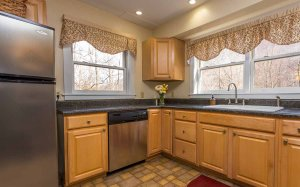 Kitchen counters, sink, and dishwasher