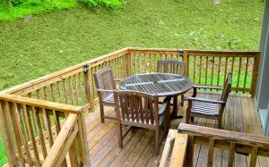 A wooden table and chairs on a deck