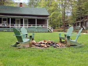 Four outdoor rocking chairs around a firepit