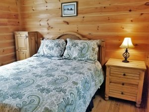 A bed in a log cabin