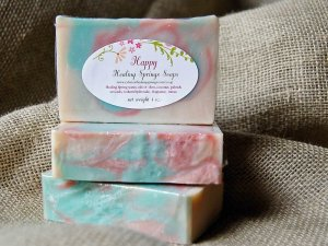 Pink, blue, and cream colored bars of soap