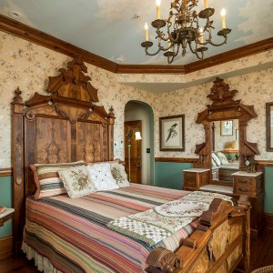Queen-sized bed with large headboard