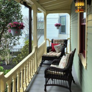 Chairs on porch with railing