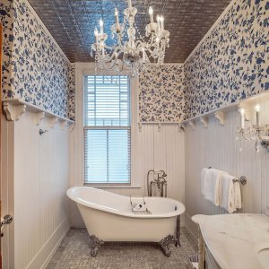 Chandelier above bathtub