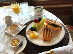 Grilled breakfast sandwich and fruit