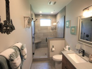 Bathroom with sink, toilet, and large shower