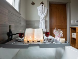 Tray of toiletries above bathtub