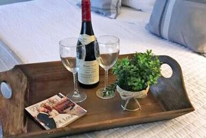 Tray with Champagne and A Small Plant