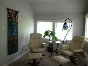 Leather seats and footrests in upstairs sitting area