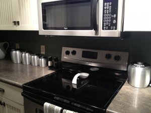 Microwave mounted above stovetop in kitchen