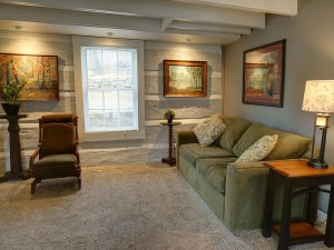 Couch next to sidetable and lamp in living room