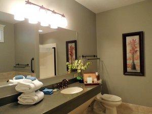 Long mirror along wall of bathroom