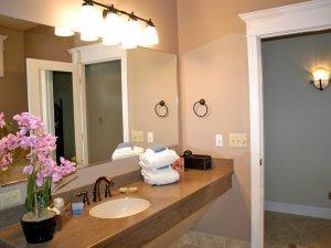 Sink countertop next to doorway to bathroom