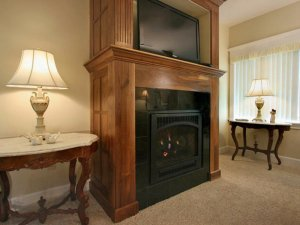 Gas fireplace next to lamp on table