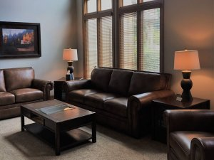 2 Leather couches and coffee table in living room