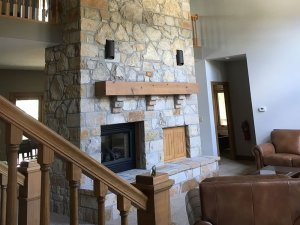 Large stone fireplace in living room