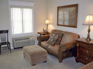 Couch and footstool next to window
