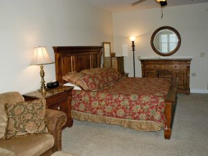King-sized bed next to endtable and lamp